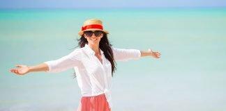 Cruise line loyalty progams woman at beach
