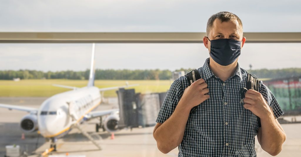 cruise safety man in mask at airport