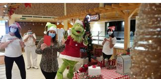 The Grinch Delivering Cards