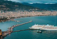 cruising cruise-ships-entering-harbor-on-a-beautiful-day
