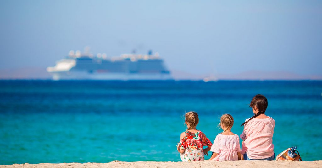 cruising family-on-the-beach-relax-and-looking-at-the-horiz